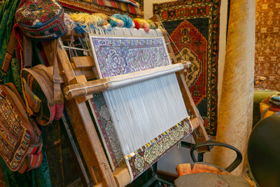 persian carpets being woven